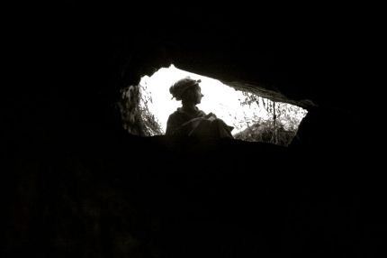 Caver at entrance, NSW