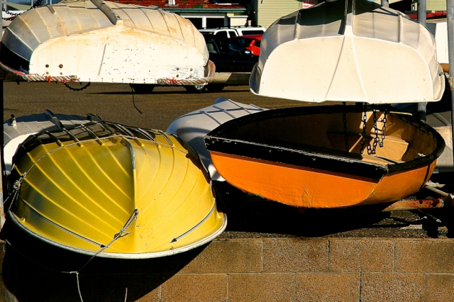 Yellow boats, stacked boats